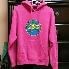 Alaska Grown Pink Sweatshirt It is used but doesn't have any holes says it's xs but I think it's more like a small Pennant sportswear Tops Sweatshirts & Hoodies