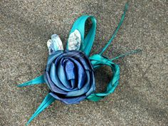 Artiflax - weddings - Blue and Turquoise flax flower buttonhole with Paua shell