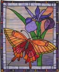 stained glass butterfly quilt would like to try to make something like this Stained Glass Quilt, Stained Glass Flowers, Stained Glass Designs, Stained Glass Panels, Stained Glass Projects, Stained Glass Patterns, Butterfly Quilt, Glass Butterfly, Flower Quilts