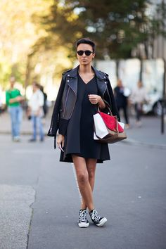 leather jacket from Sandro, dress from NA, sneakers from Converse and a bag from Céline.