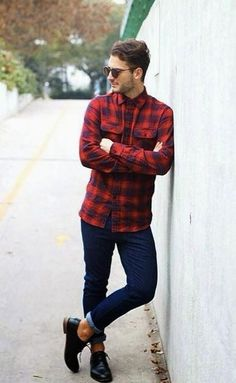 Shop this look on Lookastic: https://lookastic.com/men/looks/red-and-navy-long-sleeve-shirt-navy-skinny-jeans-black-derby-shoes-dark-brown-sunglasses/13149 — Dark Brown Sunglasses — Red and Navy Plaid Long Sleeve Shirt — Navy Skinny Jeans — Black Leather Derby Shoes