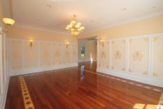 Gold raised plaster stencils in boxes with gold leaf applied to moldings in ceiling by Arlene Mcloughlin