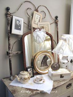 Bedroom makeover Part 3 ~ White Trash reveal / vintage headboard as photo display on dresser at http://www.funkyjunkinteriors.net/