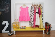 Make your own clothes rack in your Montessori home entryway or bedroom to make things child-friendly.