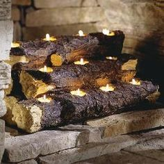 Artificial log candle holder for inside the fireplace from Plow