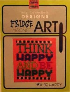 """Be Happy Fridge Art from Amy Bruecken's series titled """"Fridge Art"""". The kit contains the 3x3 magnet, mounting board, cross stitch pattern and full instructions. You supply the DMC threads and fabric (why not try 14 Ct perforated paper for an easy finish)."""