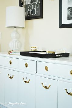 A vintage console provides great home office storage. Just add a tray to corral office supplies and a fun lamp from HomeGoods for a classy and stylish workspace. Sponsored pin.