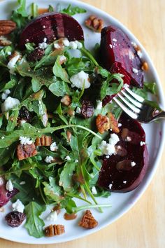 Roasted Beet Salad with Maple Balsamic Vinaigrette, candied pecans, cranberries, and goat cheese