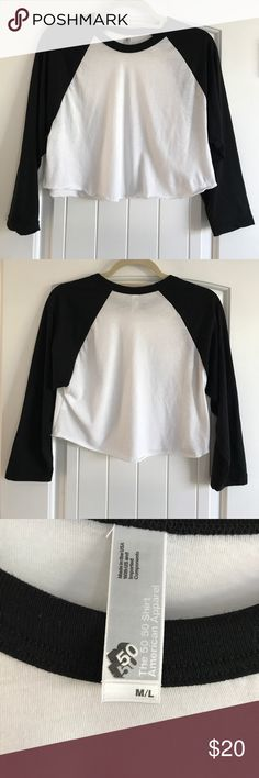 american apparel 50/50 crop top. american apparel 50/50 crop top. black + white. med/large. 3/4 length sleeves. 50% cotton. 50% polyester. super comfortable! excellent condition! American Apparel Tops Crop Tops