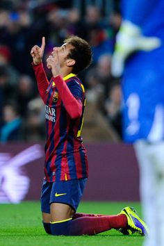 Neymar of FC Barcelona celebrates after scoring the opening goal from the penalty spot during the La Liga match between FC Barcelona and Villarreal CF at Camp Nou on December 14, 2013 in Barcelona, Catalonia.