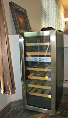 Wine Refrigerator Reviews Wine Spectator newair aw-121e 12 bottle thermoelectric wine cooler review | wine