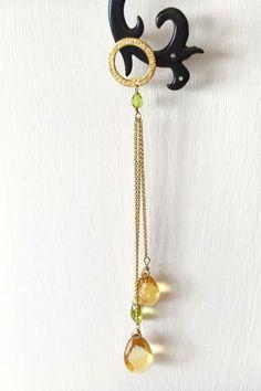 Imagine gioielli topazio smeraldo e ottone