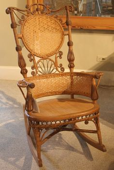 643: Victorian wicker rocker decorated with scroll