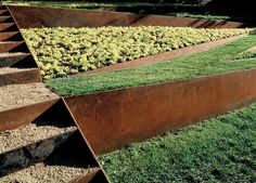 Landscaping Ideas 8 Surprising Ways to Use Corten Steel in a Garden is part of Modern landscaping - Corten steel looks good on fences, raised garden beds, and retaining walls Here are 8 surprising ways to use the weathered metal in a landscape Corten Steel Garden, Steel Retaining Wall, Retaining Walls, Retaining Wall Design, Garden Edging, Garden Beds, Garden Stairs, Modern Landscaping, Backyard Landscaping