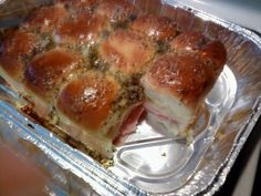 2 pkgs hawaiian sweet rolls   1lb honey ham  1lb turkey   1lb swiss cheese   1lb provolone cheese   1Tbsp honey mustard  1Tbsp poppy seeds   1 stick of butter   4 Tbsp sugar   2 Tbsp onion flakes  Cut rolls horizontally (do not split up into individual rolls) remove top.  Layer meats and cheese on the bottom and replace the top.   Mix and melt together all other ingredients in saucepan.  Let cool! Then spread on top of rolls.  Bake at 400 degrees for 10-12 minutes.