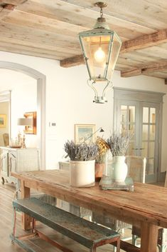 French Country decor in dining room with rustic farm table, aqua, lavender and Provence accents