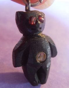 RARE Edwardian Stanhope Carved Bog Oak Teddy Bear Charm with Views of Ilkley | eBay, sold for $54.47