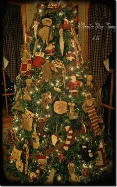 Christmas tree with DIY ornaments and hand-dyed ribbon. Description from pinterest.com. I searched for this on bing.com/images