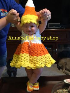 One word - Adorable! This beautiful Candy Corn Dress set is available in size 0-3 and 3-6months. Comes with hat, dress and matching shoes. Makes a great gift, perfect for a photo prop or Halloween costume
