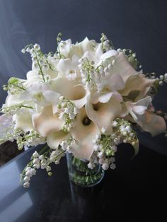 Mini Callas, Orchids & Lily of the Valley.