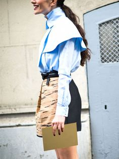 A statement button-down blouse is paired with a belted miniskirt