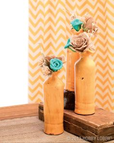 If you think real flowers are best left in the great outdoors, toss your garden shears and try this: Find a pretty vase—or in this case, a bottle—and tuck in a few whimsical burlap blooms.
