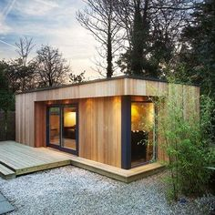 What is it about garden rooms that is so universally appealing? We're getting excited just thinking about the prospect of a seclude little spot somewhere, like this stable conversion in Kenya, that is wooden eco garden room with a green roof.: