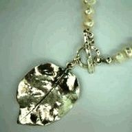 Silver leaf on a pearls necklace