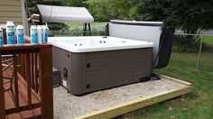 Here is a Master Spas Legacy installed on pea gravel off the deck.