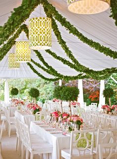 Get your wedding guests looking up with a decked out ceiling. Hanging garlands add color and help create a more intimate feel in large rooms or tented spaces.
