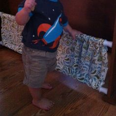 DIY baby gate. Two tension-mount shower rods and some leftover fabric! I wonder if this works!
