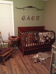 deer hunting themed nursery...LOVE the camo letters hanging from a bow! CUTE! And the deer rug <3