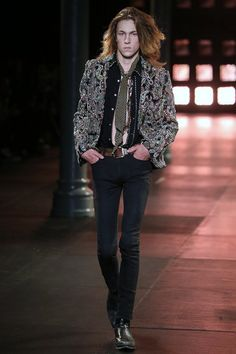 The #HediSlimane groupies got their #psychadelic rock on at #SaintLaurent Spring 2015. Skinny rocker dudes in poppy #ponchos and #leather #pants. There were also #snakeskin #boots, #army surplus #jackets, and flower #embroidered #jeans. All sexy and #brutallychic. www.ysl.com #menswear