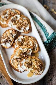 Sticky honey and earthy walnuts balance the creamy tang of fresh goat cheese in this simple crostini recipe!