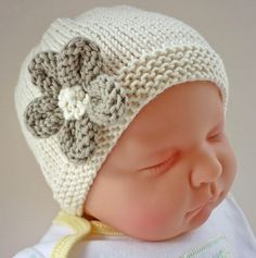 An easy to knit baby hat with a cute flower embellishment. This is really three patterns rather than one!! Instructions are given for a three colour stripe version, a ridged stripe version and a solid color version. If you are a relatively new knitter, there are plenty of step by step pictures to help you.The hat is knit in double knit yarn and the pattern gives instructions for 4 sizes from birth to 2 years