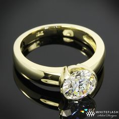 """Keystone"""" Solitaire Engagement Ring is set in 18k Yellow Gold and holds a 1.20ct A CUT ABOVE Diamond."""