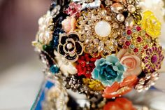 cute alternative to a wedding bouquet!  i bet you can even incorporate your grandma's old brooches!