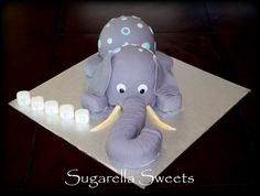 Baby shower cake idea a cute elephant with name blocks. For more ideas have a look at www.SugarellaSweets.com