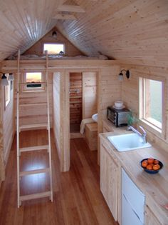 Interior of a Tiny House that I adore!  WIth skylights over the loft to let out heat and let in moon and starshine.