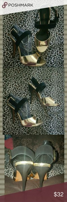* Stunning Black & Gold Heels * New in the box! Very tempted to keep these! They are just begging for a night on the town or a trip to Vegas! These are so elegant with the right amount of flash!  New in the box! Perfect condition! Luxury Rebel Shoes Heels