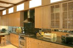 By Architectural Details and Woodworking - Custom maple kitchen cabinets with stainless steel range and hood.