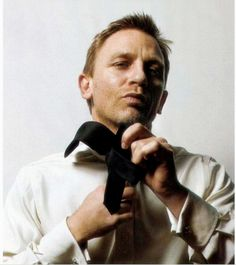 Daniel Craig... something sexy about a man tying a tie