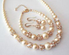 Pulsera de perlas y aretes set  gruesos  pedrería de cristal