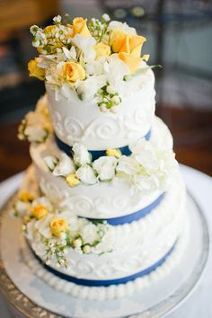A gorgeous floral & ribboned wedding cake from a real Spring Wedding! {Venue/Caterer: Conservatory at Waterstone; Photo: Brita Photography}