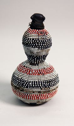 Africa | Beaded medicine gourd from the Giriama people of Kenya | 20th century | Calabash, wood, fabric, thread, glass beads, and organic substances