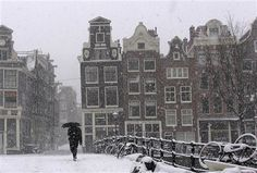 Snow covers typical Dutch scenery in the center of Amsterdam, Netherlands. (AP Photo/Peter Dejong)