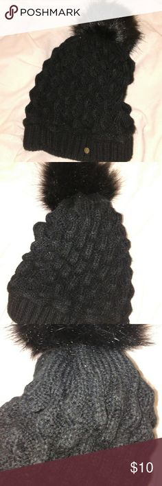 Knit black hat with pompon Knit black hat with pompon. Worn only a few times. Very warm! Accessories Hats