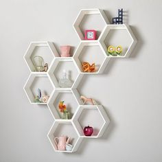 Honeycomb shelves as book storage shelf ideas can be quite unique focal point in the entire decor. DIY hexagon shelves can be learned and the plans are free on the net Honeycomb Shelves, Hexagon Shelves, Science Bedroom, Bee Nursery, Home Storage Solutions, Storage Ideas, Shelving Ideas, Shelving Design, Diy Storage