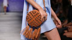 New York Fashion Week: On the runway - Rebecca Minkoff also sent her line of handbags down the runway with the models, including this fringe-lined option.