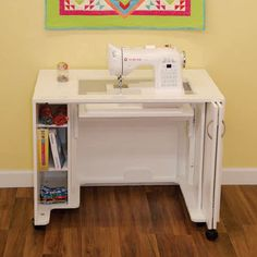 Arrow Mod Airlift Sewing Cabinet - Outfit your sewing space with the practical and polished Arrow Mod Airlift Sewing Cabinet . This sewing cabinet comes equipped with a three-position. Sewing Machine Tables, Sewing Tables, Sewing Machines, Sewing Machine Cabinets, Sewing Desk, Long Arm Quilting Machine, Sewing Cabinet, Needlework Shops, New Cabinet